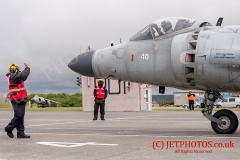 """Aircraft Handler instructors on the dummy deck facility marshall a Sea Harrier at RNAS Culdrose. The Sea Harriers are used to simulate """"live deck"""" conditions on aircraft carriers such as HMS Queen Elizabeth"""
