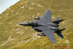 USAF F-1E Strike Eagle low level flying training in the Mach Loop (Roundabout) Snowdonia, Wales,