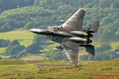 F-15E Strike Eagle of RAF Lakenheath 48th Fighter Wing, flying low level in the mach loop area of Wales (LFA7, low flying area 7) near Snowdonia