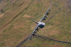 USAF Lockheed MC-130J low level flying training in the Mach Loop, LFA7 area , of Snowdonia, Wales, UK