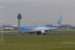 TUI 737 G-FDZB rolling for take off at Manchester Airport