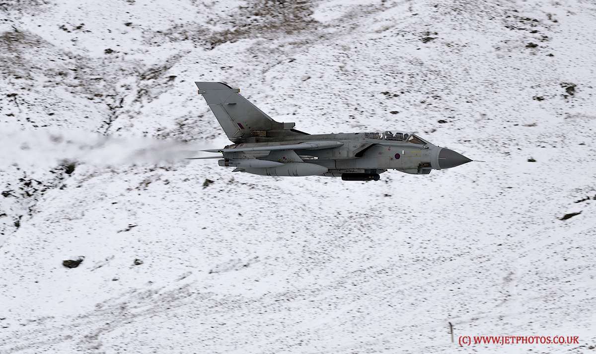 RAF Tornado Gr4 low level in Snowdonia, Wales, (LFA7) post a rent snowfall providing a great backdrop for the images.