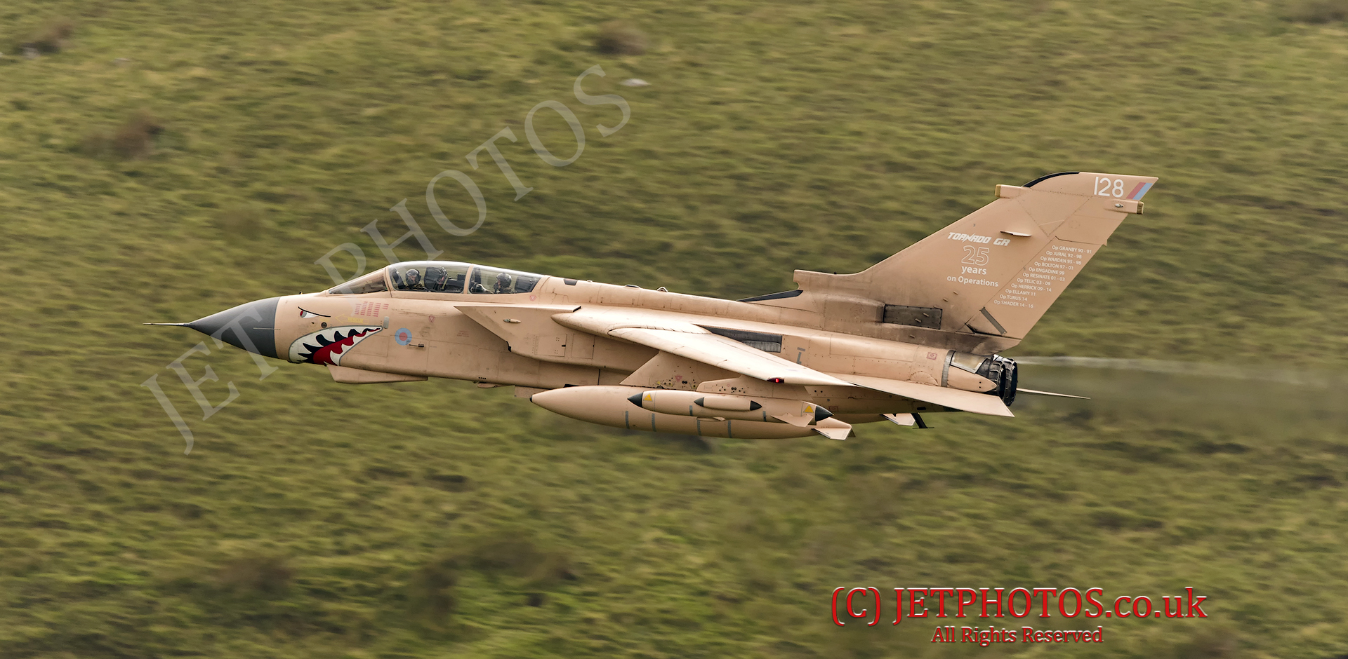 "RAF Tornado GR4 on a low level flying sortie in the Mach Loop LFA7 in Operation Granby colour scheme. Hence the aircraft identified as ""Pinky"". Scheme celebrates 25 years post Iraqi forces withdrawal from Kuwait. Battle Honours are also visible on the tail fin."