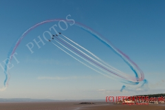 Here the Royal Air Force Red Arrows aerobatic team perform at Weston Air Festival in glorious blue skies above Weston-super-Mare