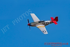 "The P51D Mustang aircraft  ""Tall In The Saddle"" during its display in blue skies, on a summer day in Weston-super-Mare, UK."