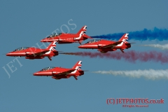 The RAF Red Arrows Aerobatic Team carr out a stunning display in blue summer skies at Weston Air Festival, located in Weston-super-Mare, UK.